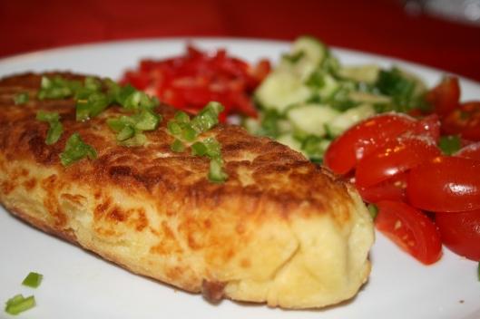Kartofflemos fritter med svampefyld.